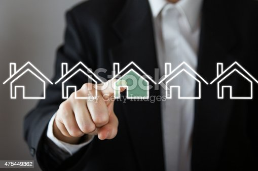 istock Businessman choosing house, real estate concept. 475449362