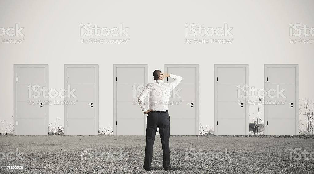 Businessman choosing the right door royalty-free stock photo