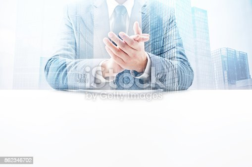 istock Businessman Clapping Hands with Double Exposure Cityscape 862346702