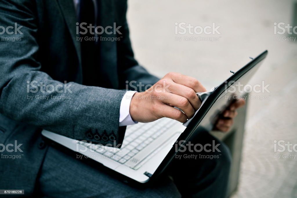 businessman cleaning the screen of a laptop stock photo