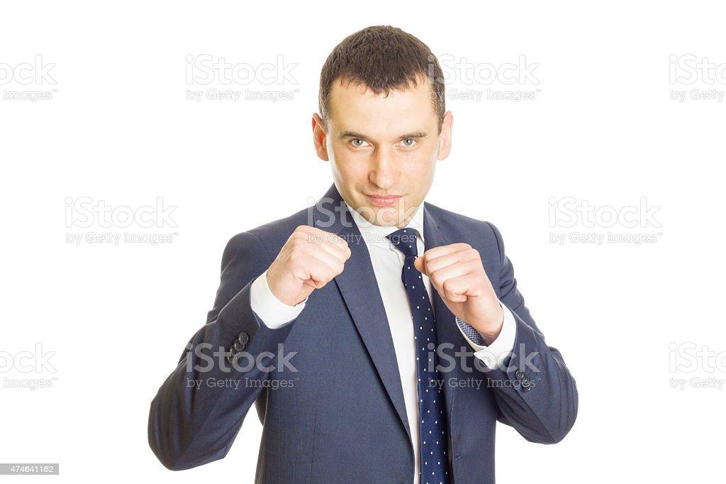 Businessman Clenching Fists stock photo