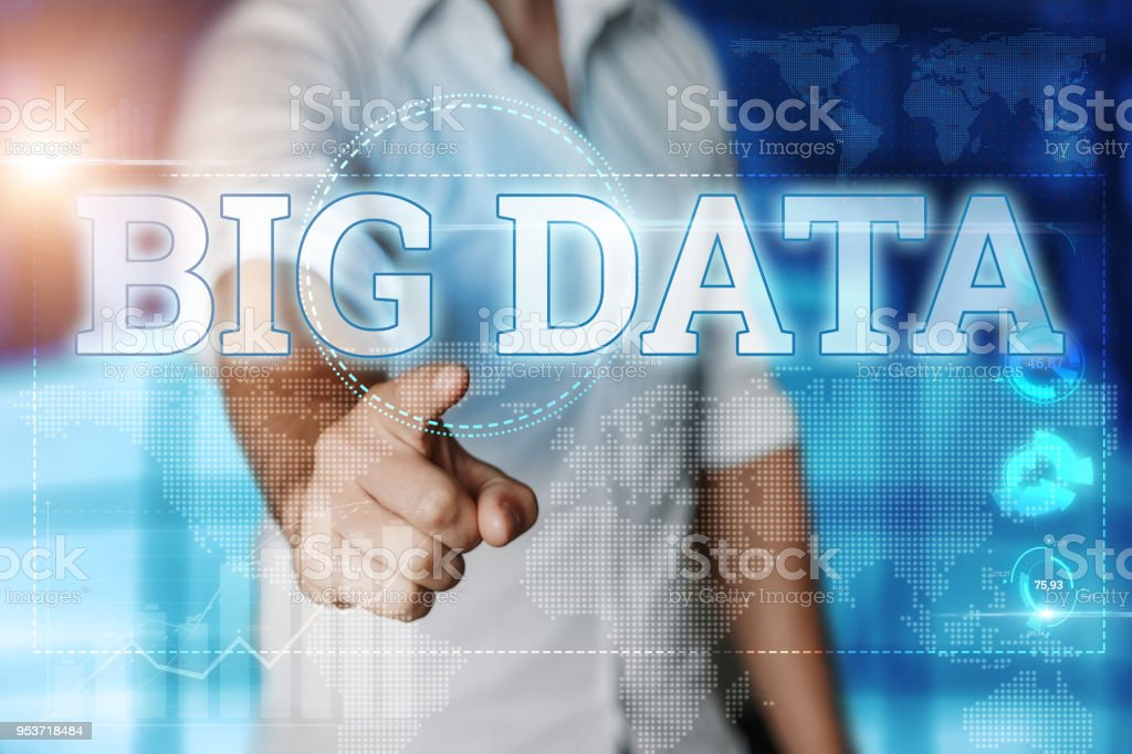 Businessman clicks on a virtual screen and selects 'BIG DATA'. Blue background. Business concept. Mixed media stock photo