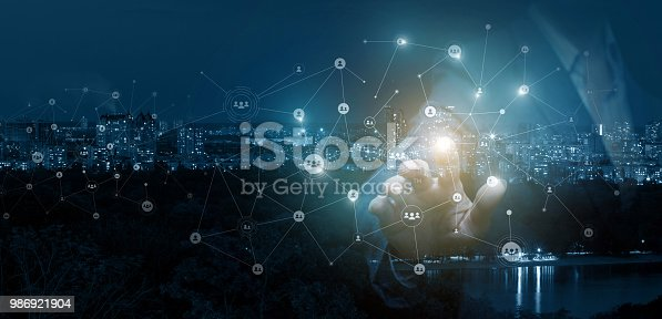 istock Businessman clicks on the avatar in the network . 986921904