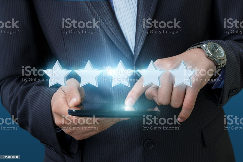 Businessman clicks on the rating in the computer. stock photo