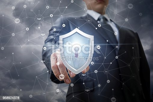 1156072209istockphoto Businessman clicks on the shield protecting the network . 958924378