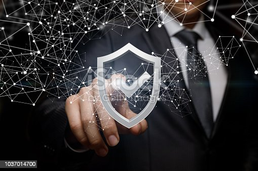 istock Businessman clicks on the shield to protect . 1037014700