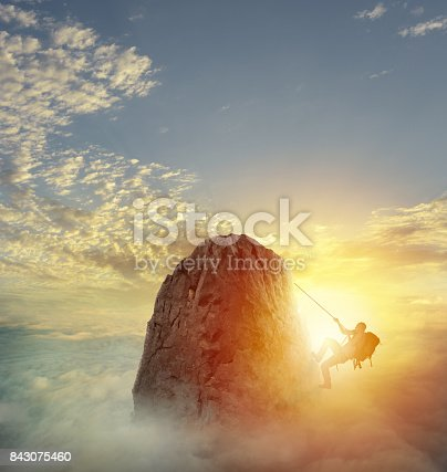 istock Businessman climb a mountain to get the flag. Achievement business goal and difficult career concept 843075460