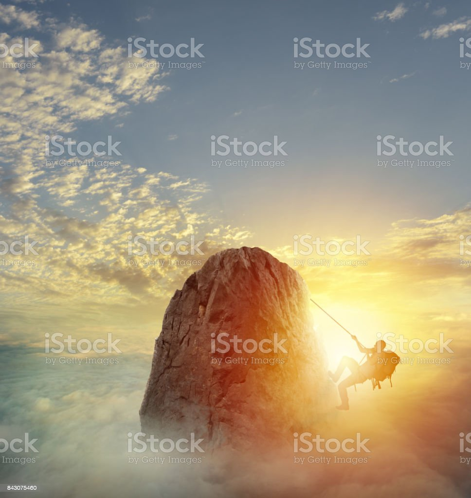 Businessman climb a mountain to get the flag. Achievement business goal and difficult career concept stock photo