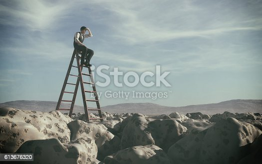 istock Businessman climbed on top of the stairs which can see 613676320
