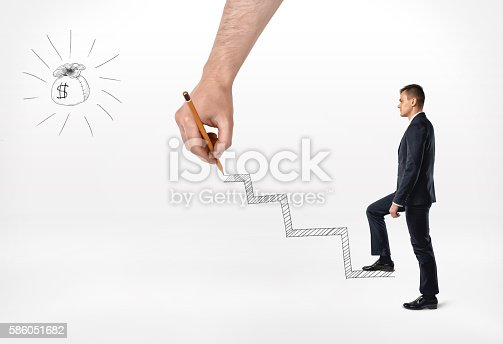 513121118istockphoto Businessman climbing hand drawn steps to the bag of money 586051682