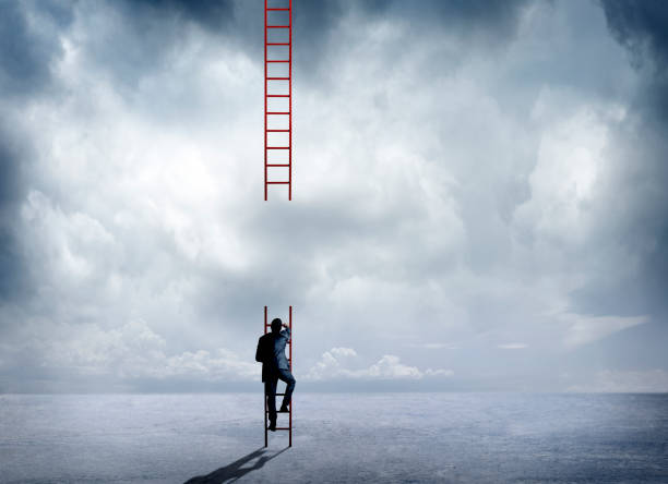 businessman climbing incomplete ladder - ladder of success stock photos and pictures