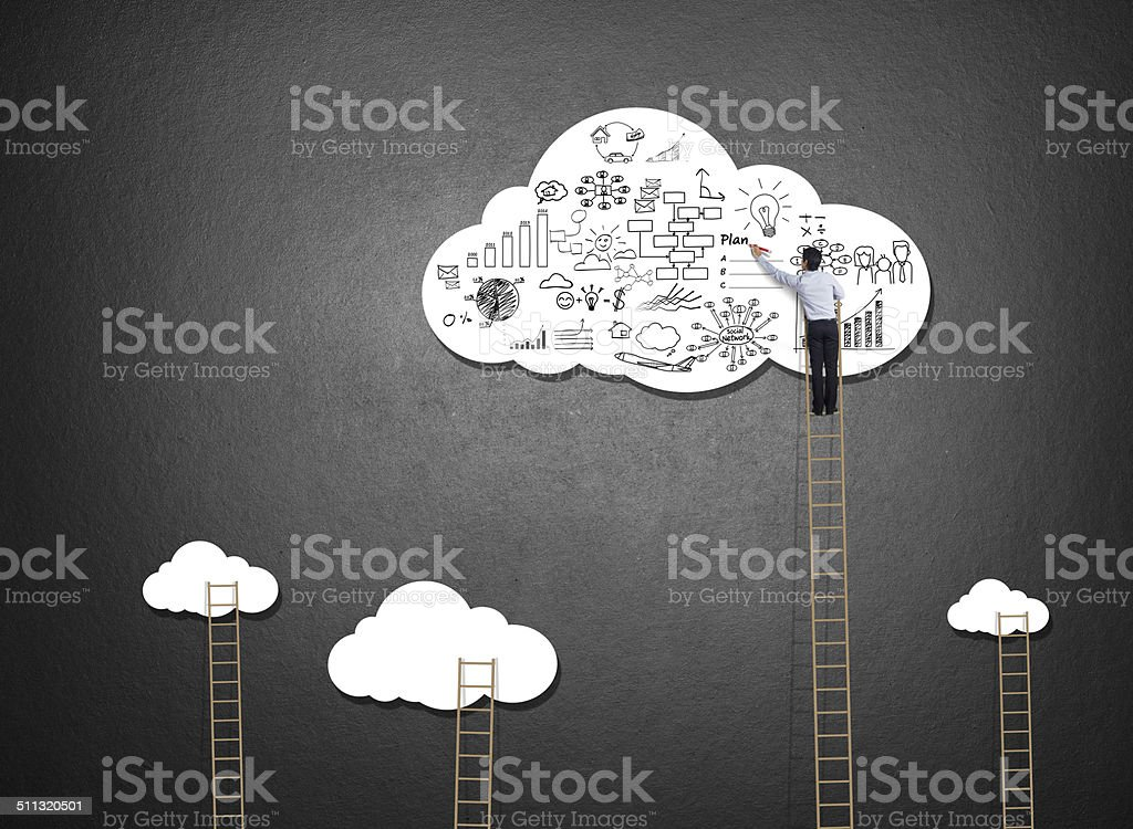 Businessman climbing ladder drawing idea on cloud stock photo
