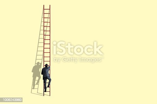 istock Businessman Climbing Ladder 1006243960