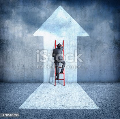 istock Businessman climbing ladder towards success 470518788