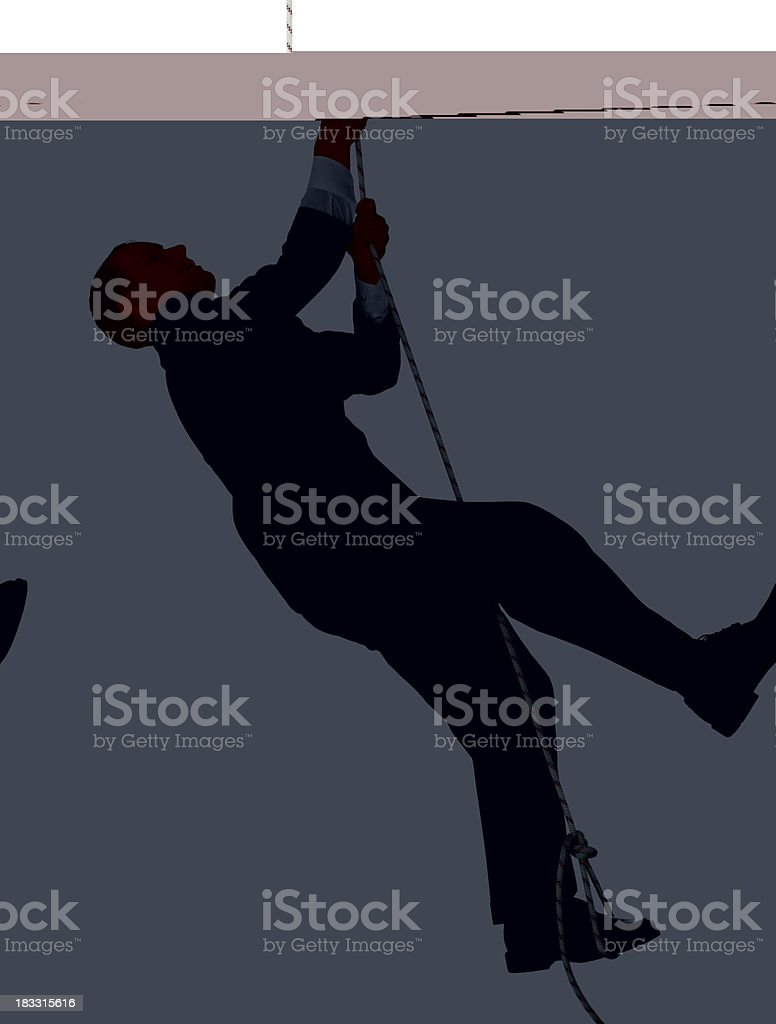 Businessman climbing rope royalty-free stock photo