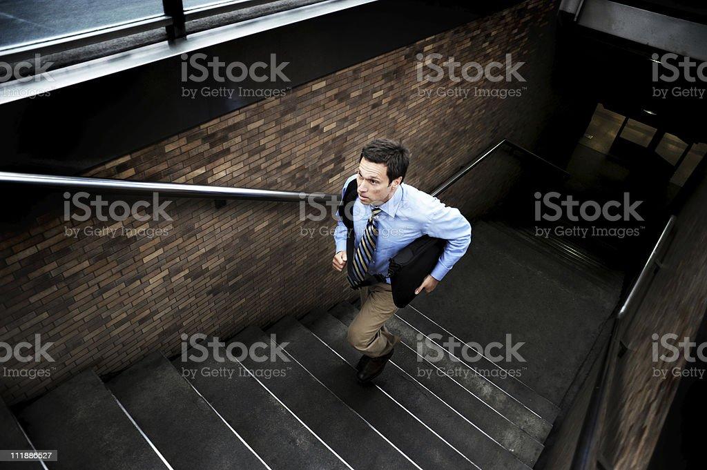 Businessman climbing stairs royalty-free stock photo