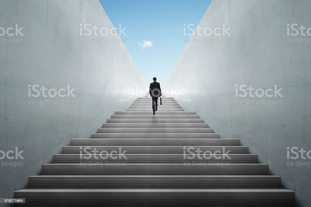 businessman climbing stairs stock photo