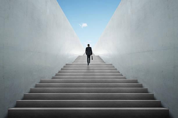 businessman climbing stairs stock photo