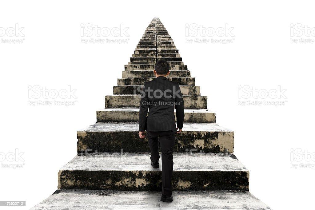 Geschäftsmann Klettern der alten Zement Treppe, isoliert auf weiss – Foto