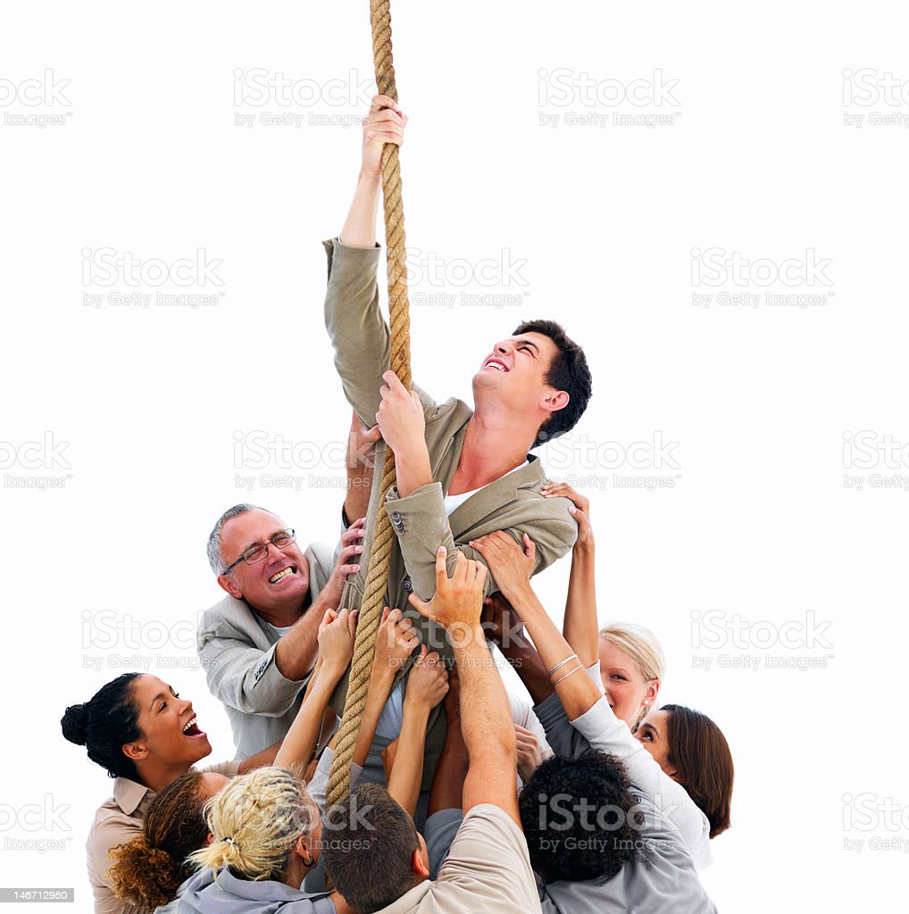 Businessman climbing up rope surrounded with colleagues royalty-free stock photo