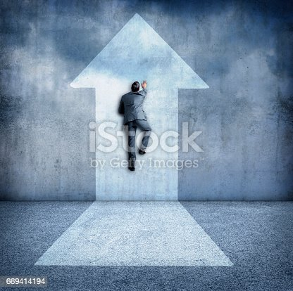istock Businessman Climbing Wall In Direction Of Arrow 669414194