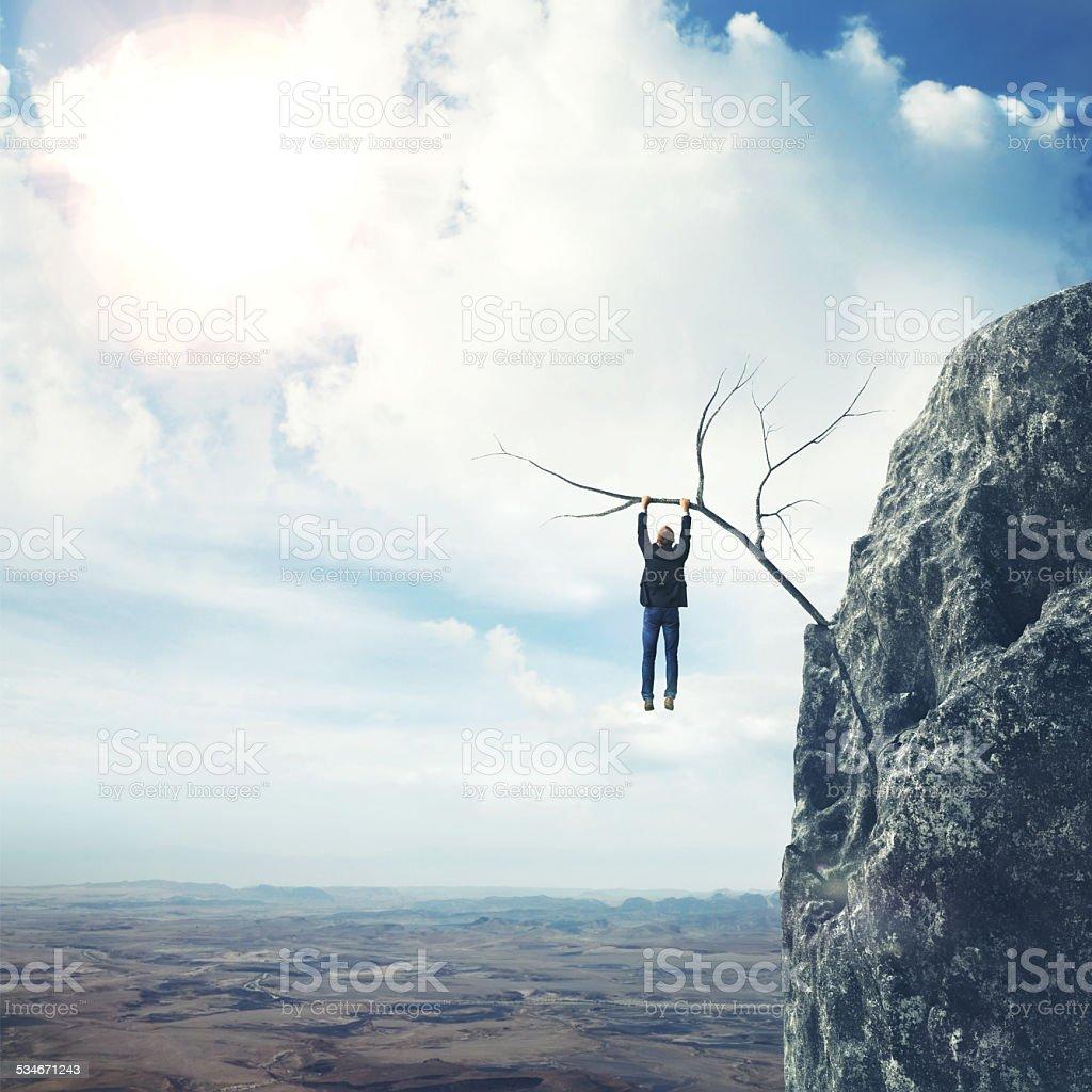 Businessman climbs a mountain stock photo