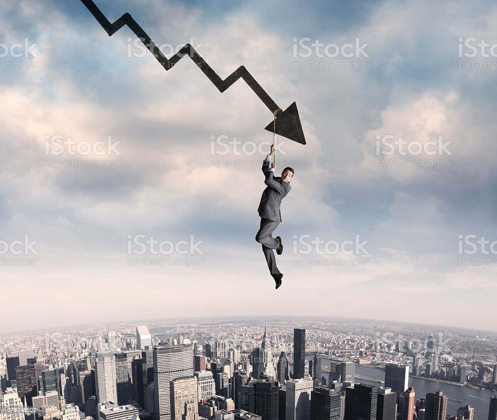Businessman Clings To Rope Dangling From Arrow stock photo