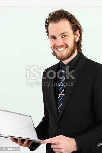 825082848istockphoto Businessman closeup with clipboard 525937155