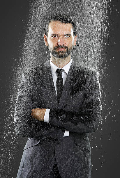businessman - cold shower - drenched stock pictures, royalty-free photos & images