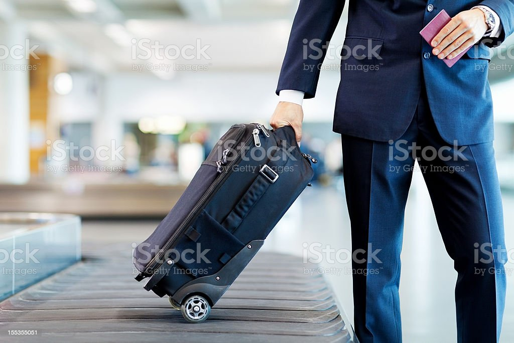 Businessman Collecting His Luggage stock photo