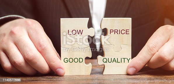 istock A businessman collects wooden puzzles with the words Low price - good quality. The concept of profitable deals for buyers. Small cost of goods. Quality service. Justified money. High rating. Marketing 1140572886
