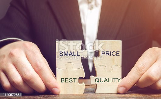 istock A businessman collects wooden puzzles with the words Small price - best quality. The concept of profitable deals for buyers. Low cost of goods. Quality service. Justified money. High rating. Marketing 1140572884