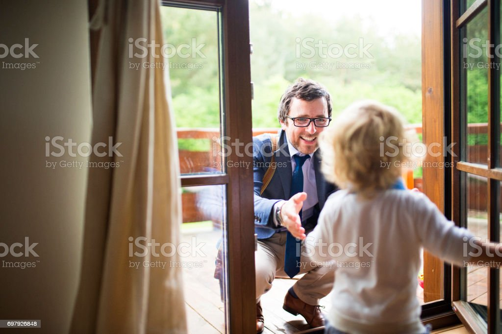 Businessman Coming Home Little Son Running Into His Arms Stock Photo