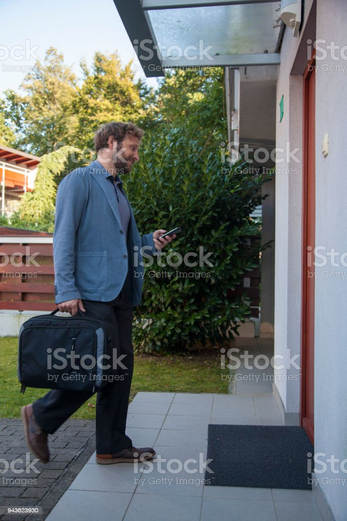 Businessman coming to a rented apartment stock photo