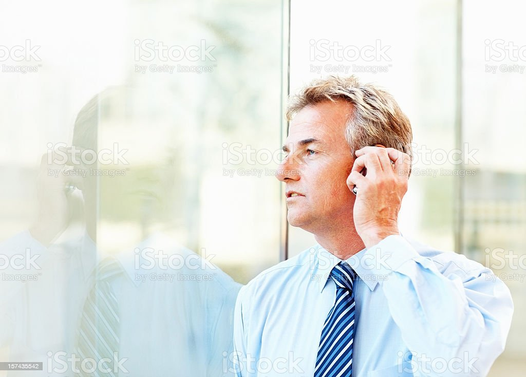 Businessman communicating on a cellphone royalty-free stock photo