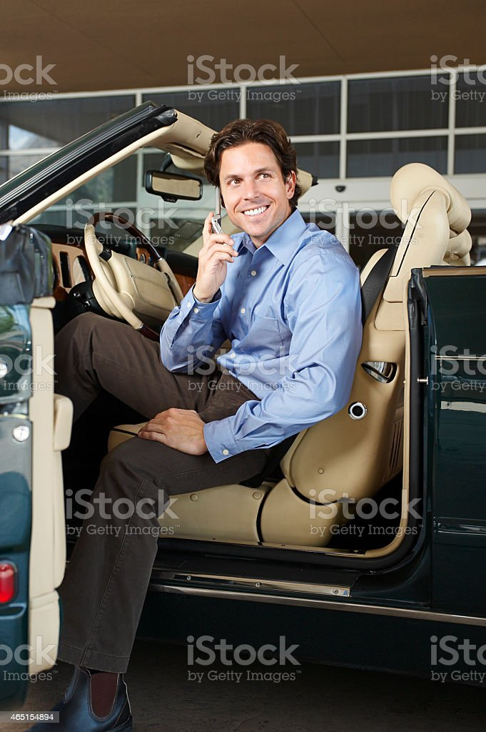 Businessman Communicating On Mobile Phone While Sitting In Conve stock photo