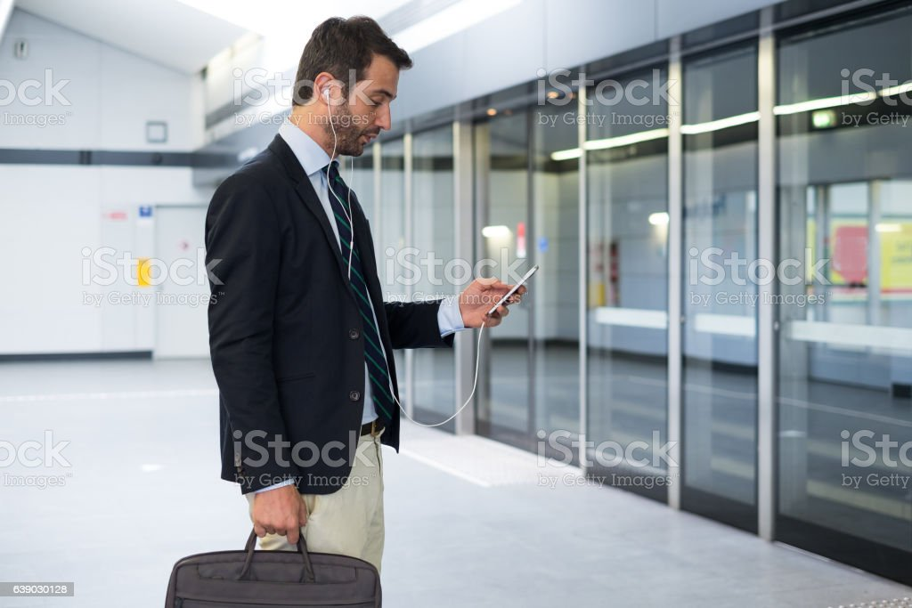 Businessman commuter traveling on the metro underground stock photo