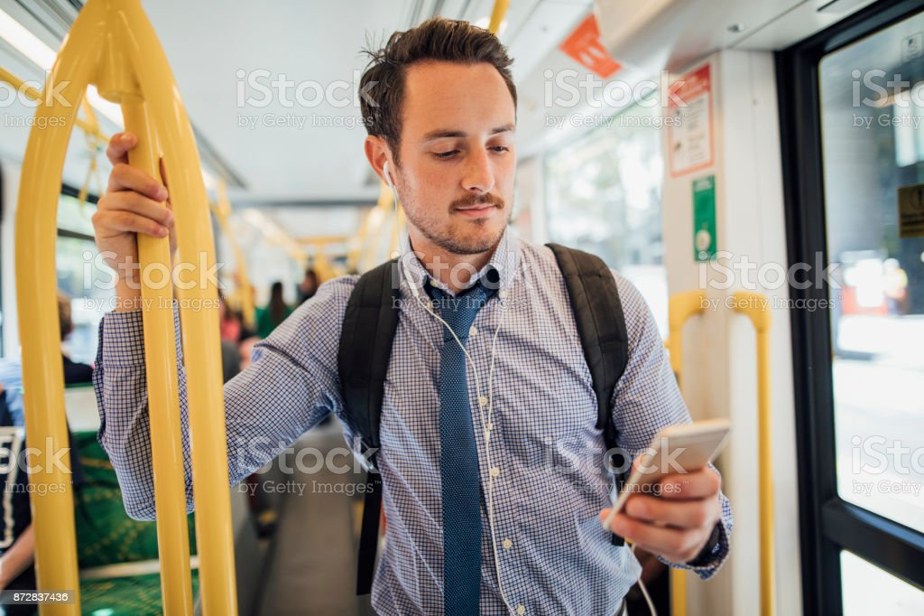 Businessman Commuting By Tram In Melbourne stock photo