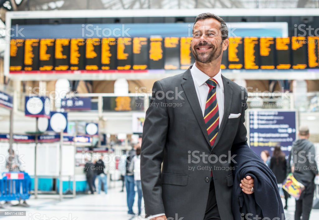 Businessman commuting from central station to suburb royalty-free stock photo