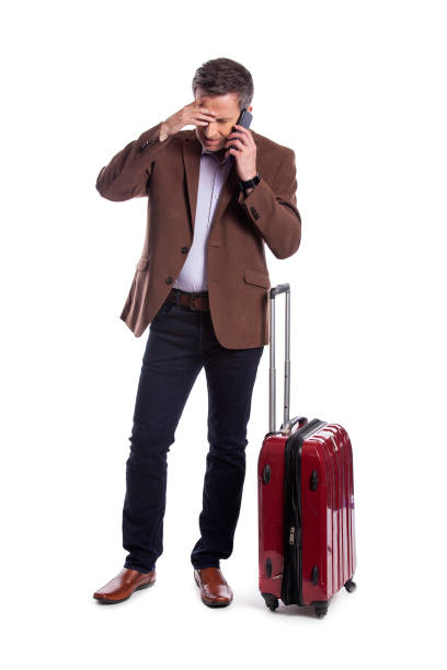 Businessman Complaining on the Phone About a Cancelled Flight stock photo