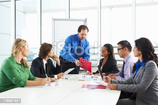 istock Businessman Conducting Meeting In Boardroom 178567937