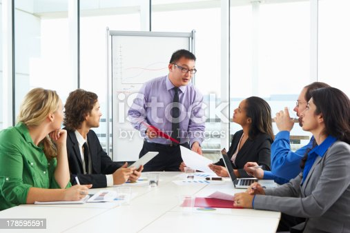 istock Businessman Conducting Meeting In Boardroom 178595591
