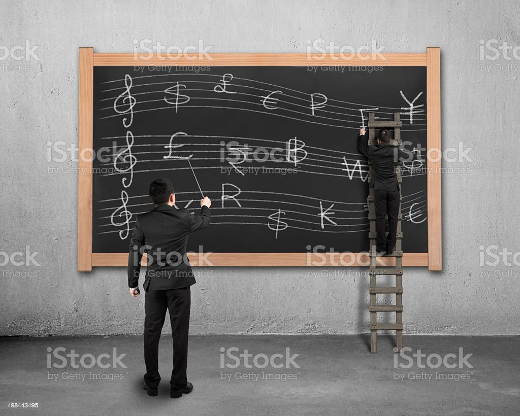 Businessman conducting with another drawing money stave on black royalty-free stock photo