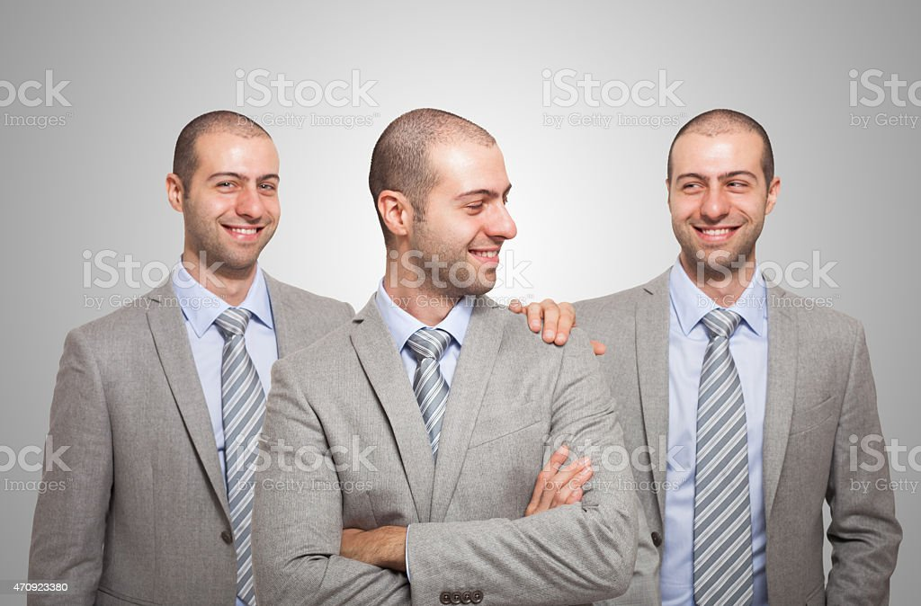 Businessman congratulating with himself stock photo