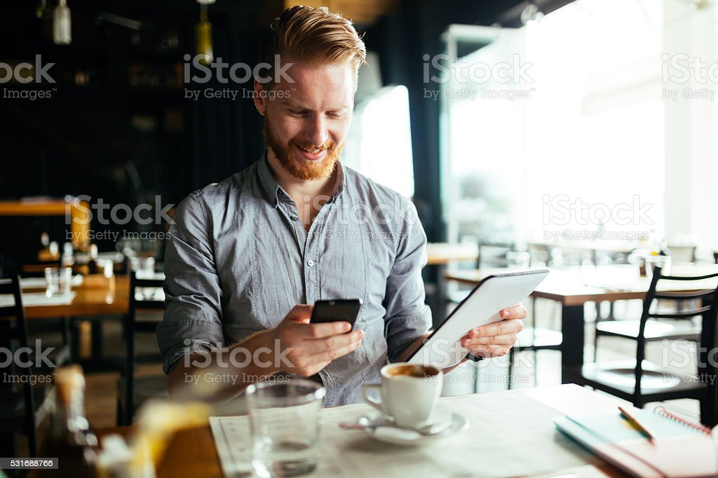 Businessman constantly working stock photo