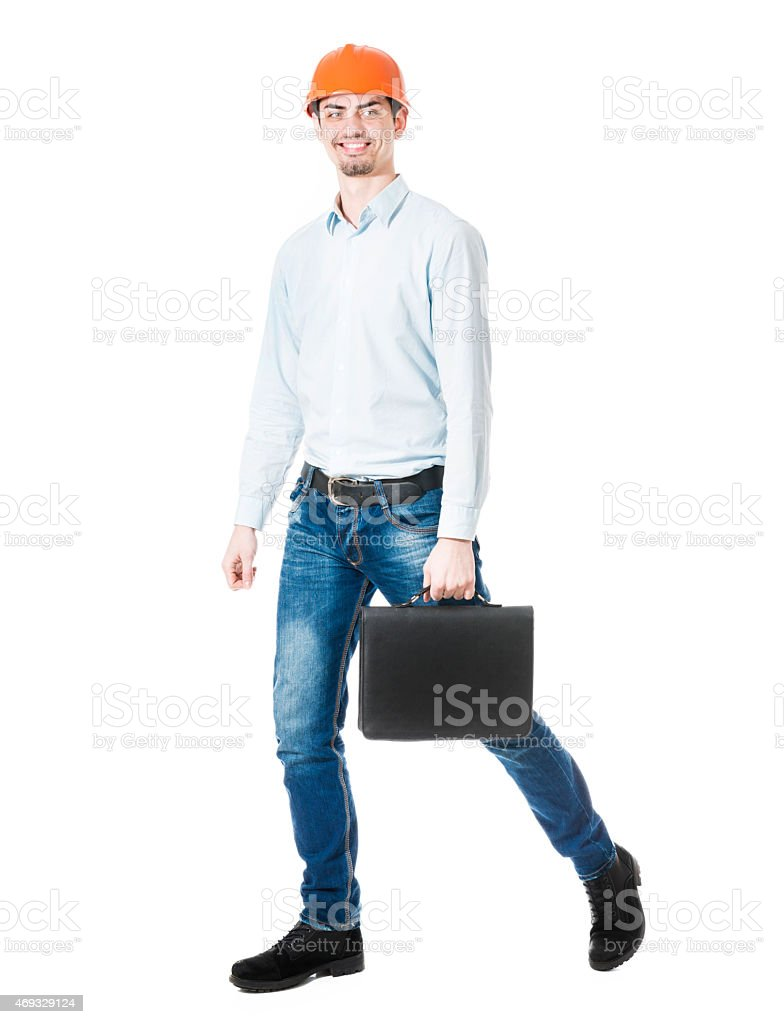 Businessman Construction Worker Walking with Hard Hat, Briefcase and Smiling stock photo