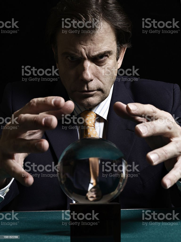 Businessman  Consulting Glowing Crystal Ball stock photo
