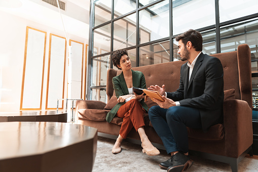 Expert, couple, businessman, sofa, workplace