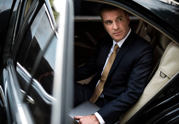 businessman corporate taxi transport service - limousine service stock photos and pictures