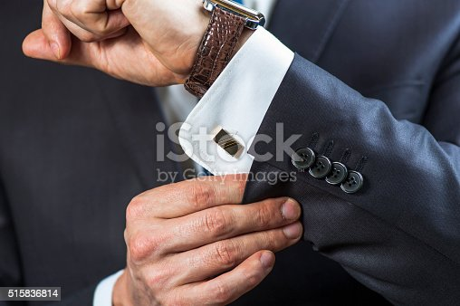 istock Businessman correcting shirt sleeve 515836814